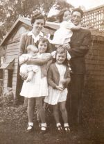 My parents, Rosemary (holding me), Sue and Mary Lou, outside the cubby house in Albany, in 1945